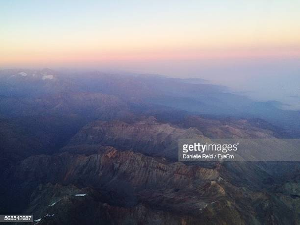 aerial view of mountains against sky during foggy weather - danielle reid stock pictures, royalty-free photos & images