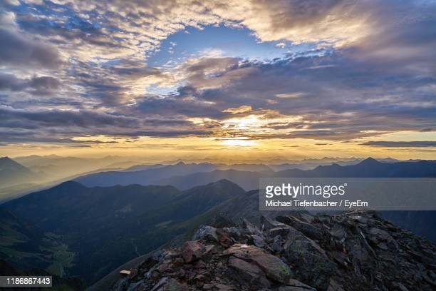 aerial view of mountains against sky during sunset - schladming stock pictures, royalty-free photos & images