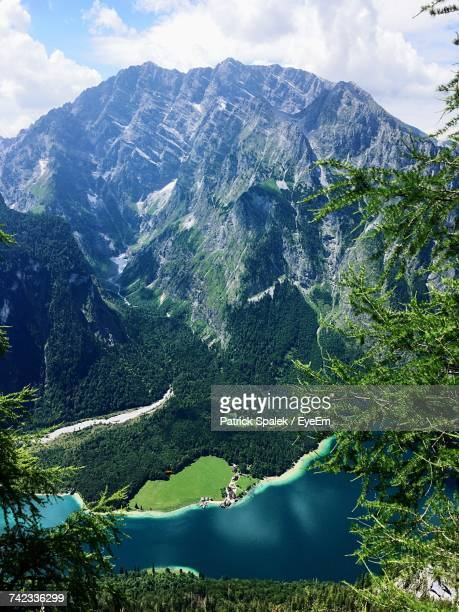 aerial view of mountains against sky - watzmann massif stock photos and pictures