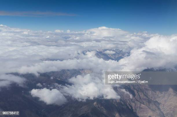 aerial view of mountains against sky - indore stock photos and pictures