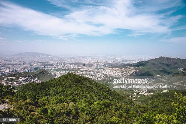 Aerial View Of Mountains And Cityscape Against Sky