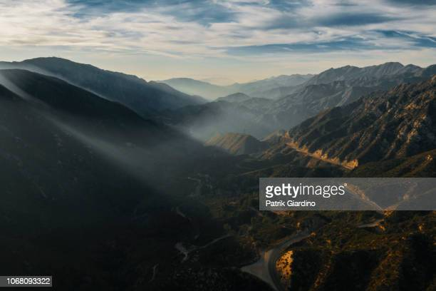 aerial view of mountains and clouds at sunset - malibu stock pictures, royalty-free photos & images
