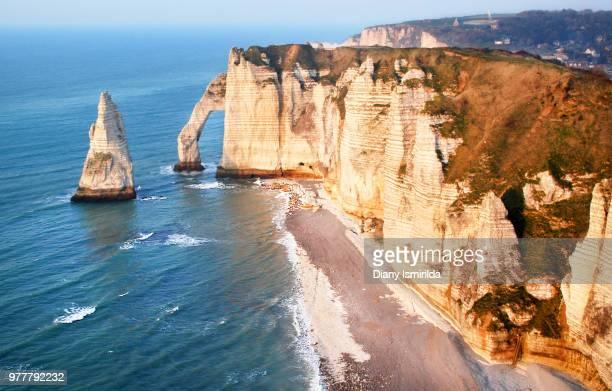 aerial view of mountains by beach, etretat, normandy, france - haute normandie stockfoto's en -beelden
