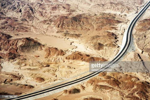 aerial view of mountains, highway road and desert on sinai peninsula near sharm el sheikh, egypt - sinai egypt stock pictures, royalty-free photos & images