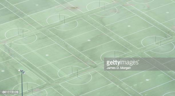 Aerial view of multiple volleyball courts from edge to edge of frame on a sunny day on March 17th 17 in Sydney Australia