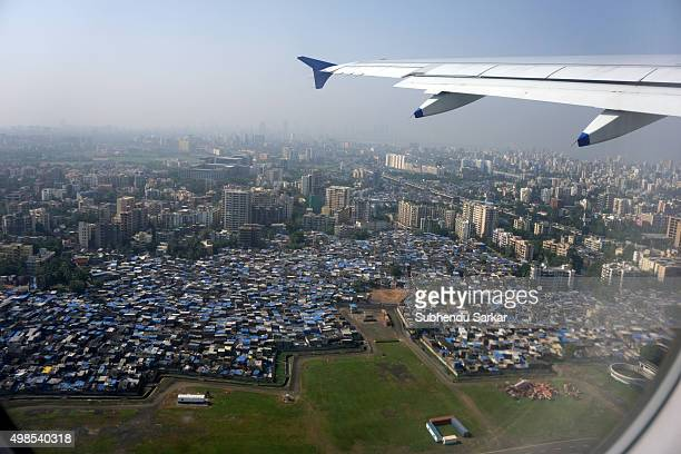 Aerial view of Mumbai city and Dharavi slums seen from inside an airplane