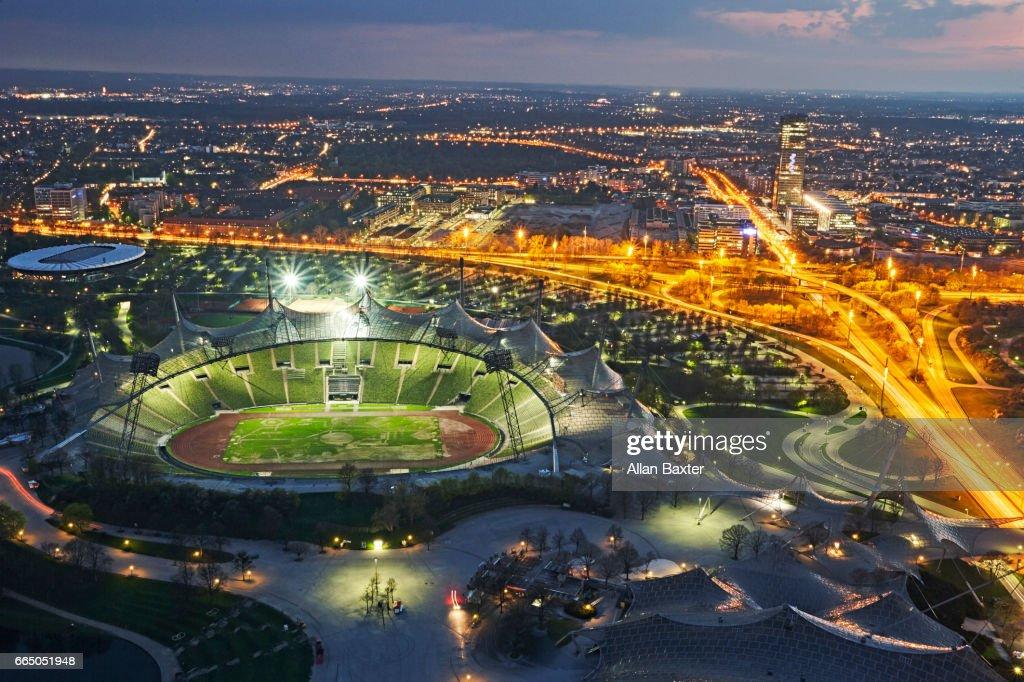 Aerial view of Munich's Olympic stadium illuminated at night : Photo
