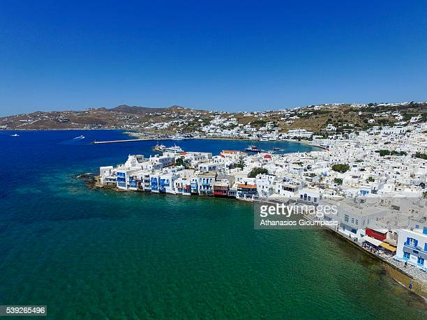 Aerial view of Mykonos town and Mikri Venetia or Little Venice on May 16 2016 in Mykonos Greece Mykonos is a Greek island and part of the Cyclades...