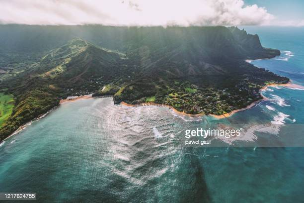 aerial view of na pali coast state park coastline in kauai, hawaii usa - hawaii islands stock pictures, royalty-free photos & images