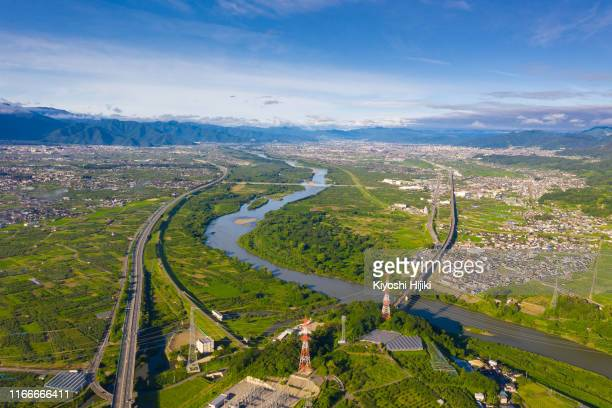 aerial view of nagano city from above, chikuma river flow through city - 長野市 ストックフォトと画像