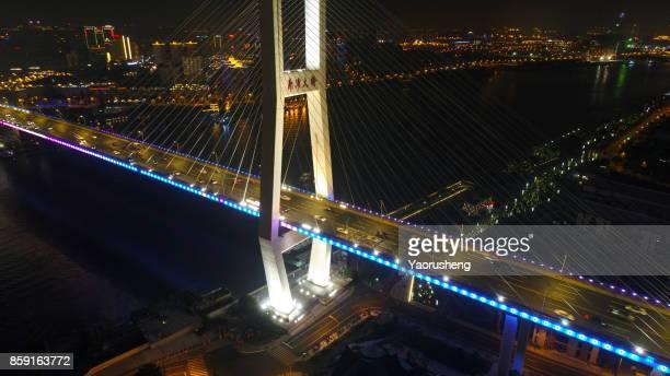 Aerial view of Nanpu bridge at night ,Shanghai ,China (by drone)