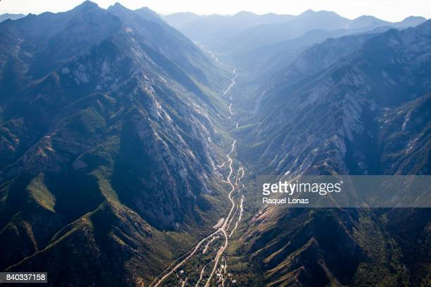 aerial view of narrow canyon road between two mountains - salt lake city utah stock photos and pictures
