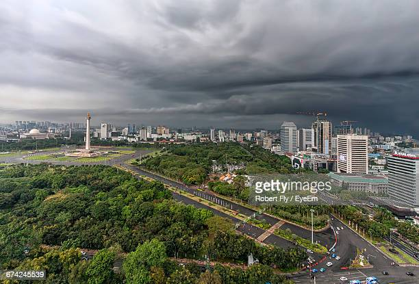 Aerial View Of National Monument In City Against Cloudy Sky