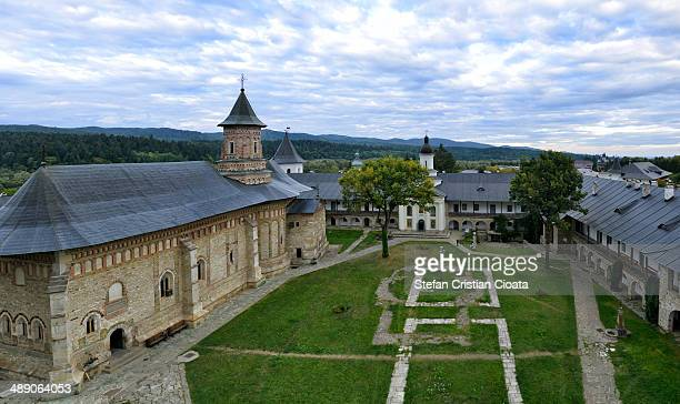 Aerial view of Neamt Monastery and the interior garden at blue hour. Moldavia, Romania.