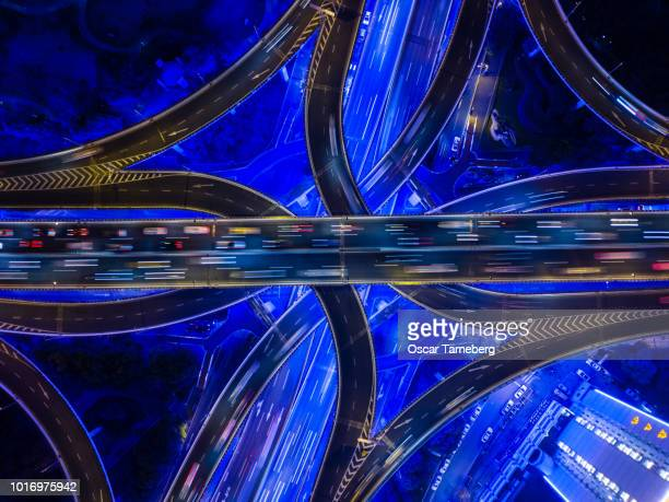 Aerial view of neon highway intersection Shanghai