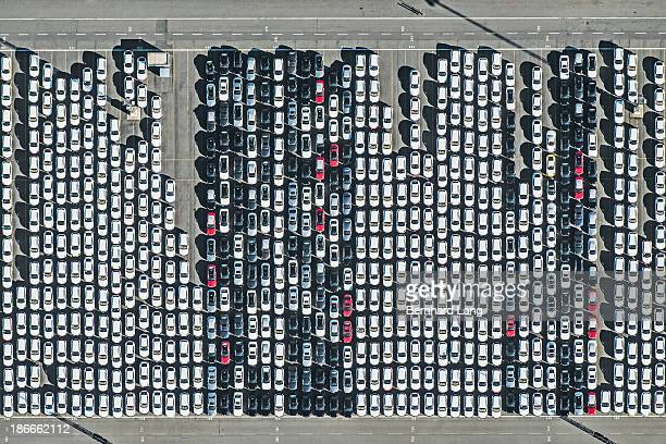 Aerial view of new cars on parking ground