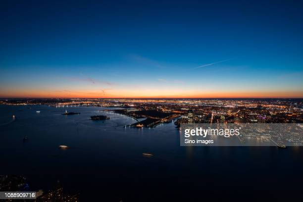 aerial view of new york at dusk, usa - image stock pictures, royalty-free photos & images