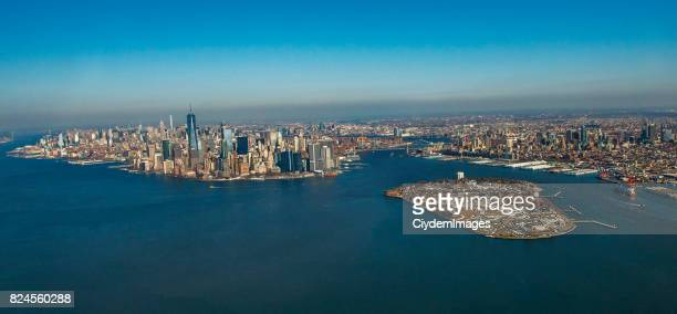 aerial view of new york city skyline and governors island through helicopter - governors island stock pictures, royalty-free photos & images