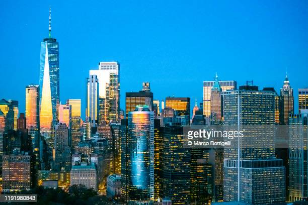 aerial view of new york city skyline at dusk - world trade center manhattan stock pictures, royalty-free photos & images