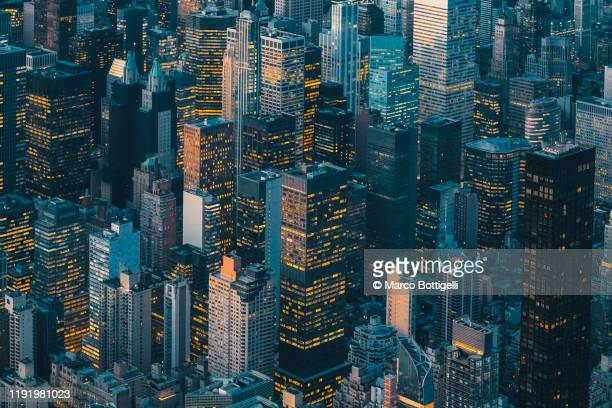 aerial view of new york city skyline at sunset - new york city stock pictures, royalty-free photos & images