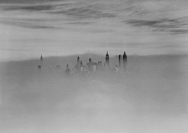 Aerial view of New York City skyline in fog, taken from abov