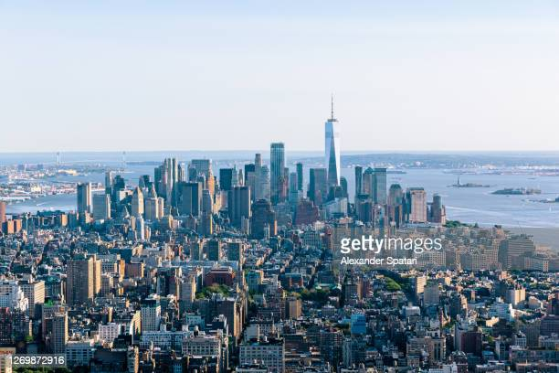 aerial view of new york skyline on a sunny day with clear blue sky, usa - north america ストックフォトと画像