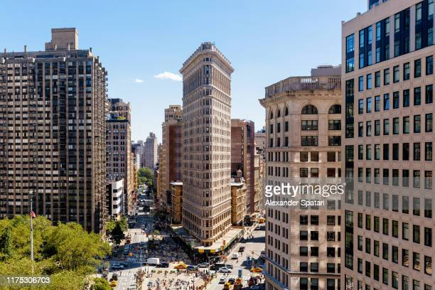 aerial view of new york skyline on a sunny day with flatiron building, new york, usa - broadway manhattan stock pictures, royalty-free photos & images