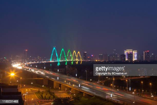Aerial view of Nhat Tan cable-stayed bridge in colorfull led light at twilight, Dong Anh district (Vietnam)