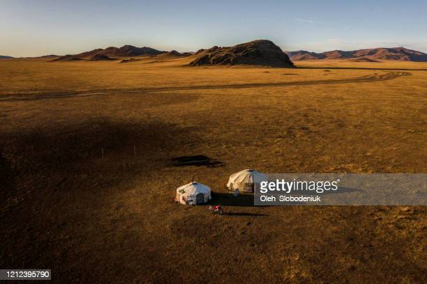 aerial view of nomadic  village in gobi desert at sunset - independent mongolia stock pictures, royalty-free photos & images