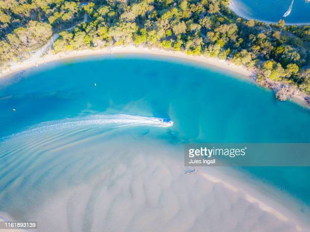 aerial view of noosa river with boat passing through - sunshine coast australia stock pictures, royalty-free photos & images