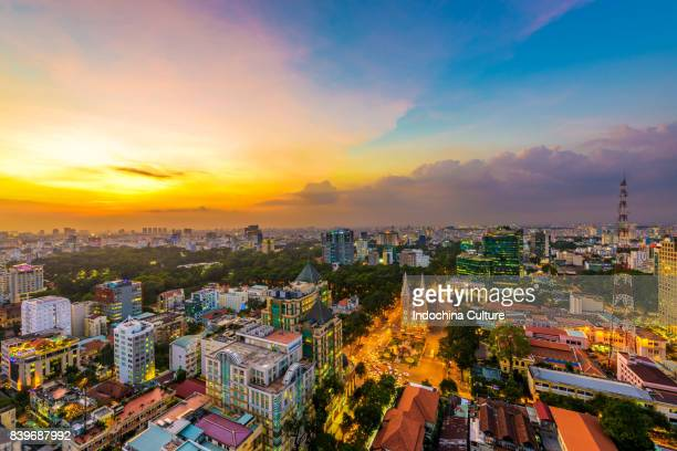 aerial view of notre dame and ho chi minh at night - ho chi minh city stock pictures, royalty-free photos & images