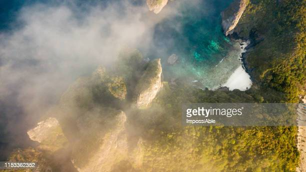 aerial view of nui beach, phi phi don island with the misty in the morning, andaman sea , krabi, thailand - impossiable stock pictures, royalty-free photos & images