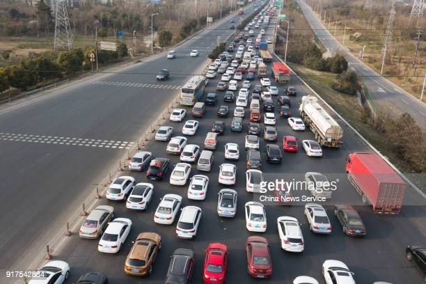 Aerial view of numerous cars traveling around the toll station on the Nanjing Second Bridge Expressway on February 11 2018 in Nanjing China Travel...