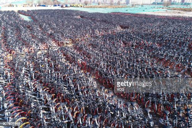 Aerial view of numerous idle shared bikes lined up at an open space on January 17 2018 in Yinchuan Ningxia Hui Autonomous Region of China Bike...