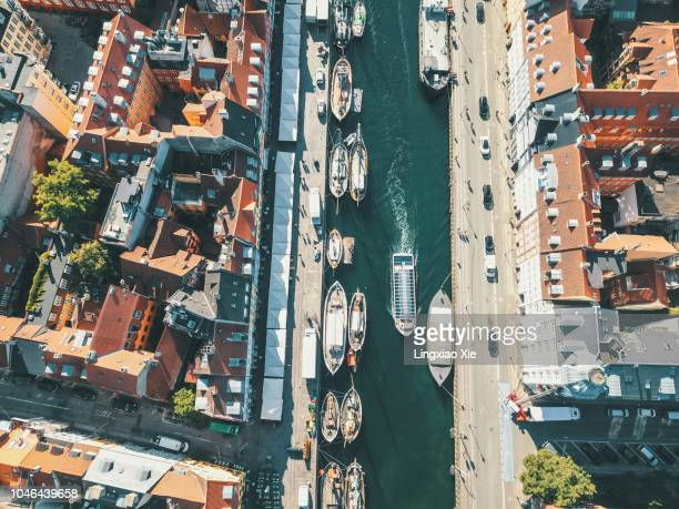aerial view of nyhavn (new harbour) at dawn, copenhagen, denmark. taken by drone from straight above. - denmark stock pictures, royalty-free photos & images