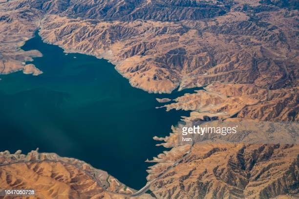 aerial view of oasis and desert - digital composite stock pictures, royalty-free photos & images
