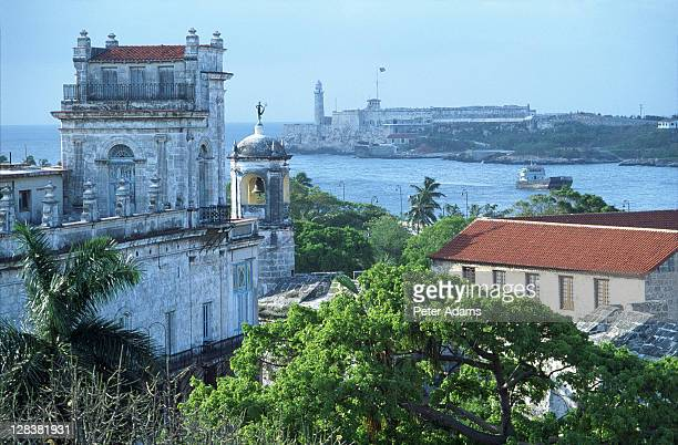 aerial view of ocean and building, havana, cuba - peter adams stock pictures, royalty-free photos & images