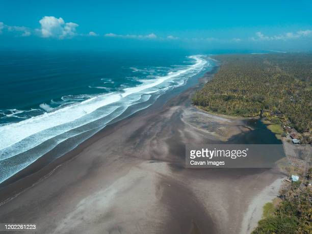aerial view of ocean coastline - denpasar stock pictures, royalty-free photos & images