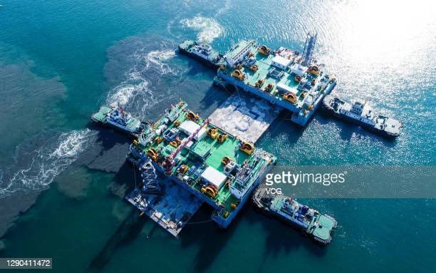 Aerial view of Ocean engineering vessels Jin An 2 and Jin An 3 as the first immersed tubes of Dalian Bay Undersea Tunnel is ready to be installed on...