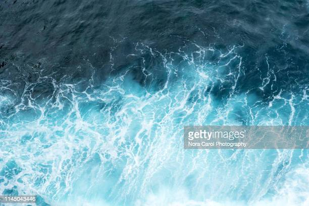 aerial view of ocean waves - wave stock pictures, royalty-free photos & images