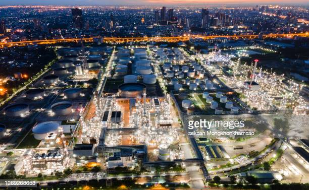 aerial view of oil and gas industry - refinery, shot from drone of oil refinery and petrochemical plant at twilight, bangkok, thailand - greenpeace stock pictures, royalty-free photos & images