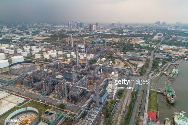 aerial view of oil refinery and gas industry in petrochemical plant at twilight - saudi arabia stock pictures, royalty-free photos & images