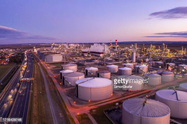 aerial view of oil refinery at sunset. - oil refinery stock pictures, royalty-free photos & images
