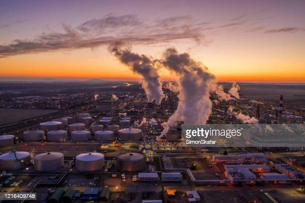 aerial view of oil refinery at sunset. - climate change stock pictures, royalty-free photos & images