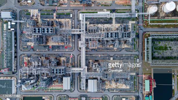 aerial view of oil refinery plant in evening time. - qatar stock pictures, royalty-free photos & images