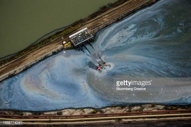 aerial view of oil sands operations - oil sands stock pictures, royalty-free photos & images