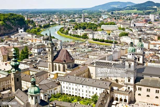 aerial view of old town of salzburg seen from hohensalzburg castle, salzburg, austria - salzburg stock-fotos und bilder