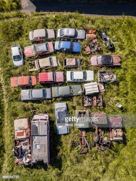 Aerial view of old vehicles in the grass