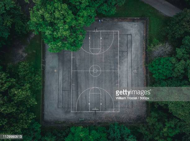aerial view of outdoor basketball court in park - sports court stock pictures, royalty-free photos & images