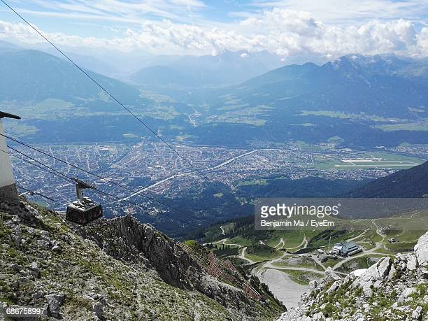 Aerial View Of Overhead Cable Car With City In Background